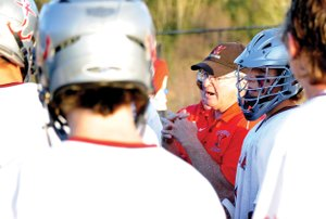 Steamboat boys lacrosse coach Bob Hiester talks with his team in the waning moments of Saturday's 9-4 playoff victory against Denver East. The team will travel to face Kent Denver next, playing Wednesday.