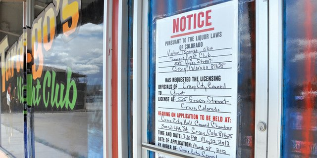 A notice of a liquor license hearing May 22 for Tarango's Night Club hangs on the door Monday at 535 Green St. Residents are circulating a petition against the liquor license approval, which they plan to present Tuesday to the Craig City Council.