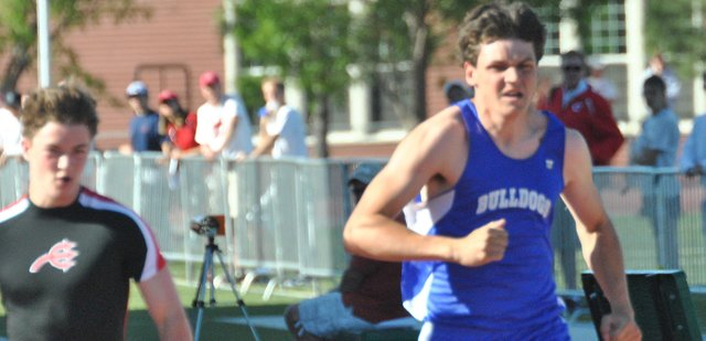 Moffat County High School senior Andy Browning pulls ahead during the 100-meter dash at the Tiger Invitational Saturday in Grand Junction. Browning placed fifth in the event and second in the 200-meter, as well. The MCHS boys placed sixth overall.