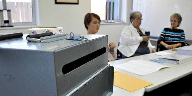 A ballot box sits Tuesday in the Craig Fire/Rescue station, 419 Yampa Ave., as election judges Kirstie McPherson, left, Peggy Hough and Linda Riley, right, wait for voters. The polls are open from 7 a.m. to 7 p.m. today.