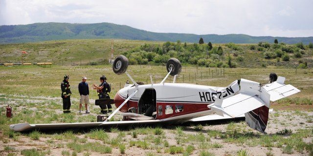 Three men were able to walk away from an aircraft that flipped onto its roof during a crash landing shortly after noon Saturday at Steamboat Springs Airport.