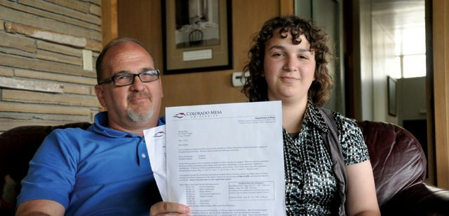 Kaitlen Bird, 18, and her father, Joe Bird, look over her acceptance letters from Colorado Mesa University and its music department in their Craig home. In light of decreasing employment rates for recent college graduates, Bird said he hopes he can help Kaitlen avoid taking out loans to pay for her education.