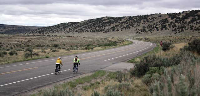 "Participants in the ""Where the Hell's Maybell?"" bike ride prepare to round a corner Saturday a few miles past Lay on U.S. Highway 40.  The 26th annual event drew a smaller crowd than anticipated due to cold weather."