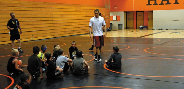 All-American wrestler Joe Leblanc speaks to local youth wrestlers during a camp Saturday at Hayden High School. Leblanc, a Meeker native, graduated from the University of Wyoming in May and has accepted a job to become the Indiana University assistant wrestling coach. He showed wrestlers basic, important techniques and also spoke about the importance of a good work ethic.