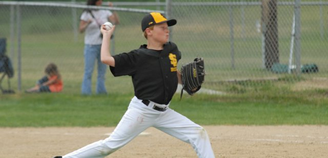 A pitcher for the Sandlot Bees throws during the teams Triple Crown baseball game in the Steamboat Mountain Magic Triple Crown Baseball tournament at Loudy-Simpson Park Friday. A record 87 teams attended the tournament this year, and games were played in Craig, Hayden, Steamboat Springs and Oak Creek. The finals of the tournament will be Sunday in Steamboat Springs.