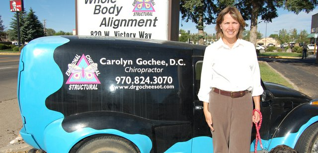 Carolyn Gochee and her mastiff, Maya, head out for the day in the parking lot of Whole Body Alignment. Gochee, 35, is a chiropractor who has lived in Craig since 2004. The car pictured is a refurbished 1969 Volkswagen, which she uses to promote her practice, and the logo on it is a butterfly detailing the state of growing bodily health.