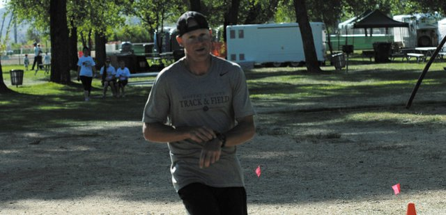 Todd Trapp, Moffat County High School's cross country and track coach, crosses the finish line Saturday at the inaugural Wake the Whittler 5K Run and Walk. Trapp was the first overall finisher in the race, which was hosted at Loudy-Simpson Park as part of the Whittle the Wood Rendezvous weekend.