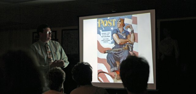Tom Daly, left, Norman Rockwell Museum curator of education, discusses an illustration Norman Rockwell painted for The Saturday Evening Post during a presentation Saturday morning at the Museum of Northwest Colorado. Daly pointed out similarities between the illustration and Michelangelo's painting of the prophet Isaiah in the Sistine Chapel to illustrate how Rockwell took inspiration from great artists of the past.
