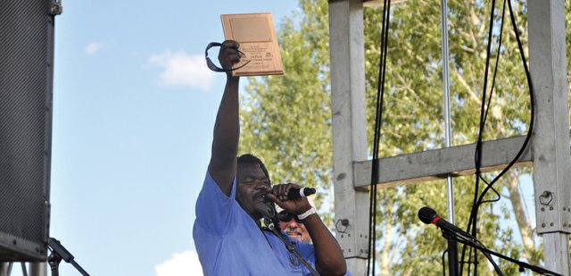 Bongo Love, of Lafayette, holds up the Peoples Choice award he won Saturday in the Whittle the Wood Rendezvous carving competition at Loudy-Simpson Park. Love also took first place in the Judges Choice category with his carving titled Crocodile Sundae.