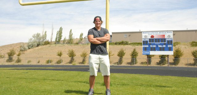 Moffat County High School graduate Brady Conner stands on the Bulldog Proving Grounds where he used to play football. Conner is preparing for his sophomore year at Adams State University, where he will be a red-shirt freshman on the football team.