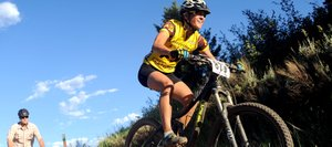 Mindy Mulliken flies off a jump Wednesday at the Town Challenge Mountain Bike Race on Emerald Mountain in Steamboat Springs. The event drew nearly 200 riders.