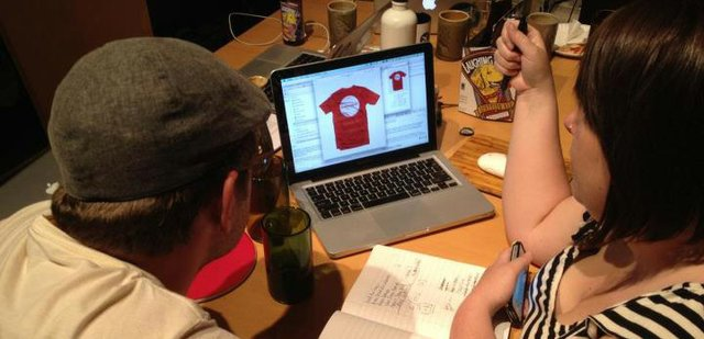 Troy and Sara DeRose, co-founders of Wild Fire Tees, look over submissions from the public for their second round of t-shirts. Wild Fire Tees launched online Wednesday to raise funds for Colorado wildfire relief efforts. To date the company has sold more than 13,500 t-shirts and raised more than $270,000.
