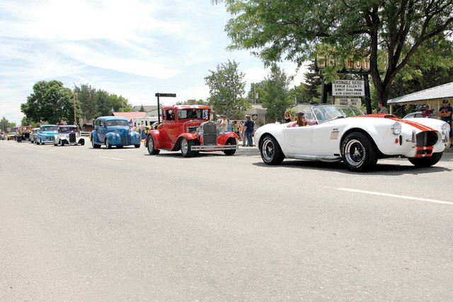 A string of classic cars drives down Victory Way during the 2011 Independence Day parade. This years parade is scheduled to start at noon Wednesday at Veterans of Foreign Wars Post 4265, 419 E. Victory Way, and will continue down Victory Way to Craig Post Office, 556 Pershing St.