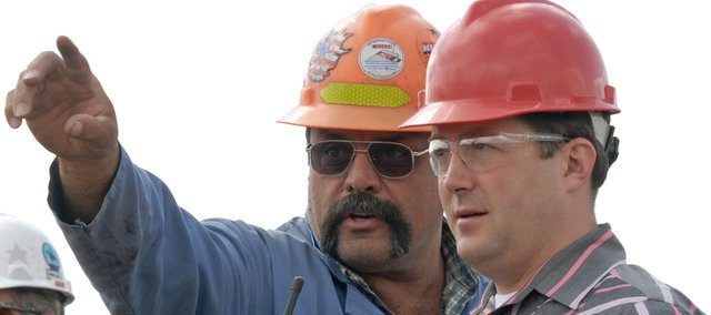 Trapper Mine employee Doug Schneider, left, explains to Sal Pace, a Pueblo Democrat running for Colorados 3rd Congressional District, where dynamite has been laid during a blast demonstration at Trapper Mine in Craig. Pace visited with Trapper Mine officials as part of a seven-day, 23-stop listening tour of 3rd Congressional District.