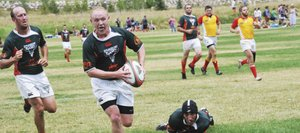 Tucker Brock scores a try Saturday during the 38th annual Cow Pie Classic rugby tournament. Steamboat won the tournament for the fifth time in six years, beating Wyoming, 13-8.