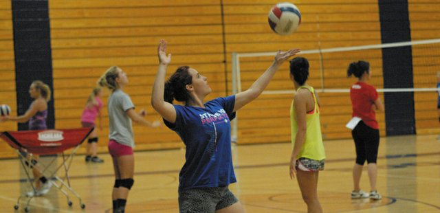 Jessica Behrman, an incoming senior at Moffat County High School, serves the ball during a drill Tuesday at the MCHS gym. The Volleyball team is taking part in a skills camp led by Colorado Northwestern Community College volleyball coaches.
