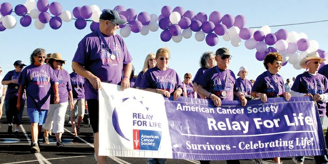 Craig residents participate in the opening survivors lap during the 2011 Relay for Life event at the Moffat County High School track. This year's charitable endeavor, which benefits the American Cancer Society, will kick off at 6:30 p.m. Friday at the MCHS track.
