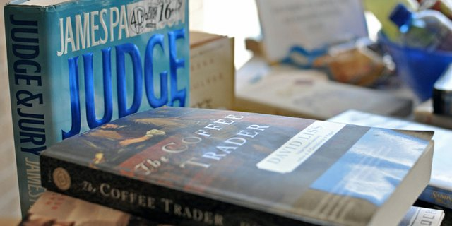 Books lie stacked on a table during a book sale in late June outside the Craig branch of the Moffat County Libraries. The library, 570 Green St., is hosting a book sale throughout the year with the Friends of the Moffat County Library to fund ongoing improvements. The library also recently began selling snacks and drinks for summer readers.