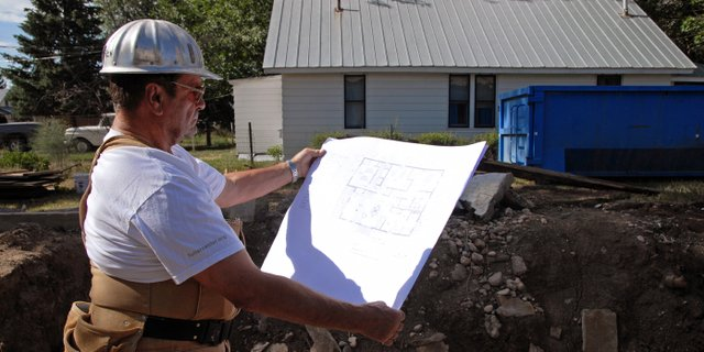 Neil Folks, president of the Moffat County Fuller Center for Housing, reviews plans for a single level, three-bedroom home in Craig. The Fuller Center will begin accepting applications Wednesday from low-income families.