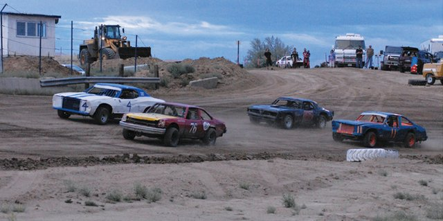 Cars round the track during hot laps at Thunder Ridge Motorsports Park at a race July 28. The dirt racing track, located on Ranney St. two miles south of Craig, will swap cars for trucks this weekend, hosting mud drag races and truck pulls on its infield.