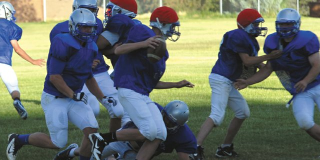 Quarterback Matt Hamilton tries to avoid the defensive rush at Moffat County High School during the football team's camp in June. The Bulldogs' schedule for this season has been released. The first game is Saturday, Sept. 1 against Ridgeview Academy at home.