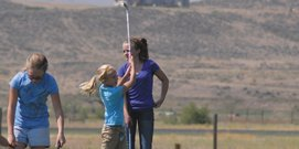 Halle Hamilton, 8, hits from the driving range at Yampa Valley Golf Course Wednesday. Hamilton was one of 12 girls to take part in a Ladies Professional Golf Association Girls Golf Day. The program, led by Moffat County High School girls golf coach Ann Marie Roberts, helped girls ages 4-16 with their swing and understanding of golf.