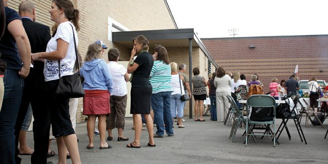 Moffat County School District teachers line up Wednesday for lunch at Craig Middle School during teacher orientation. Local educators have been hard at work preparing for the start of the new school year on Monday.