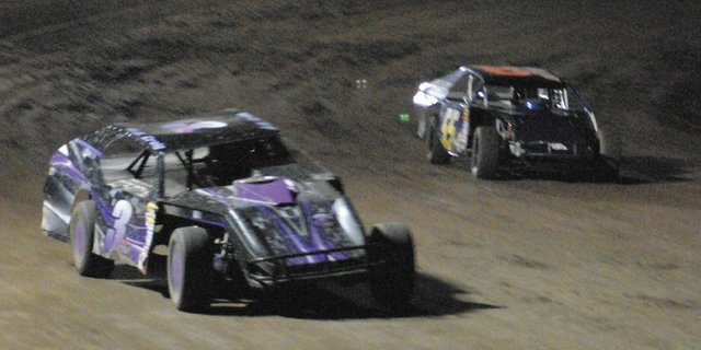 HD Craig (No. 3) and Gregg Kolbaba (No. 55) jockey for position during the modified stock car race at Thunder Ridge Motorsports Park Saturday night. Craig won the race.