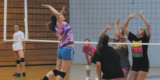 Moffat County High School senior Jessica Behrman goes up for a kill during team practice last week in the MCHS gym. Behrman is one of two seniors on the volleyball team, and the only returning senior.