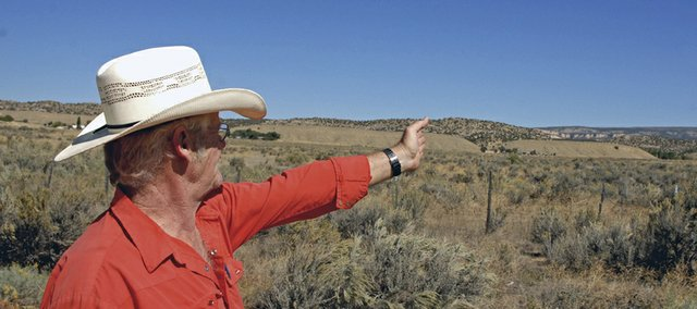 Dinosaur Mayor Pro Tem Richard Blakley looks in 2011 out on a 155-acre tract of land known as the old Papoulas ranch, which was identified as a potential location for an Indian-owned casino in Dinosaur.