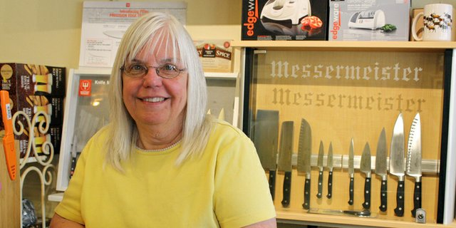 Nadine Daszkiewicz, who owns and operates the Kitchen Shop of Craig with her husband Mike, leans on the counter in front of a knife display at her business on Yampa Avenue. Daszkiewicz got her start running a bakery before the business evolved into a kitchen supply store.