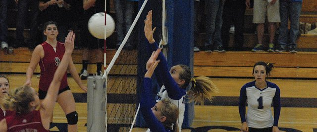 Laurel Tegtman (front) and Brittney Rothermund go up for a block during the second set of Tuesday&#39;s match against Grand Valley at Moffat County High School. The Bulldogs won in five sets.