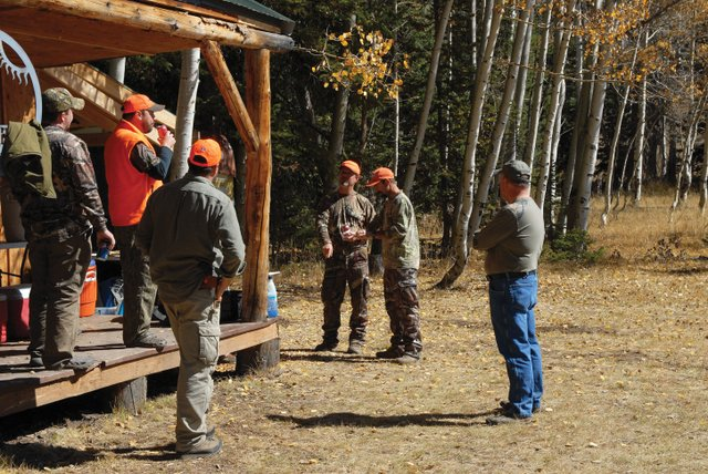 Writers and Editors from national hunting magazines, including Brad Fenson of North American Hunter (speaking), Adam McKean of Outdoor Life Magazine (right of Fenson) and Mike Schoby of Petersen's Hunting Magazine (in foreground), came to Craig earlier this month to go elk hunting with Elkhorn Outfitters. They hunted at Elkhorn's Pilot Camp.