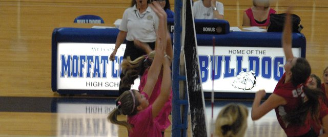 Lauren Samuelson (front) and Kelsie Pomeroy (behind), go up for a block Thursday during the Moffat County volleyball team's game against Aspen High School. The Bulldogs, wearing pink for breast cancer awareness, won in five sets, 22-25, 25-22, 25-19, 21-25, 15-9.