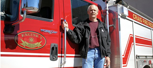 Battalion Chief Dennis Jones stands on Craig Fire/Rescue's Engine 3 for what could be the last time. Jones on Thursday officially announced his retirement from the fire department after 23 years of service. His last day is Friday, Oct. 26, which also is Jones' 53rd birthday.