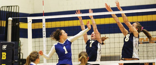 Moffat County&#39;s Brittany Walker sends a shot over the net during last Tuesday&#39;s volleyball match at Rifle. Moffat County won that match in three sets. The Bulldogs will go to the Western Slope League tournament at Grand Junction Central High School this weekend.