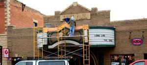 Work is done on a temporary fix to some stucco that fell from the Chief Theater's marquee. Friends of the Chief, the nonprofit that bought the theater, plans to open a temporary theater while fundraising continues for a modern performing arts venue.