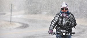 Steamboat Springs resident Annette Seiler rides her bike home from work Wednesday afternoon in Steamboat Springs. Snow flurries greeted pedestrians, cyclists and motorists in downtown Steamboat as the first winter storm of the season arrived as scheduled.