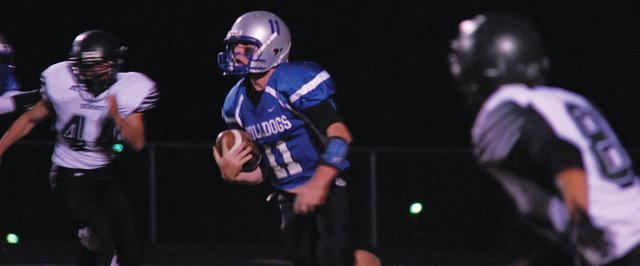 Bubba Ivers carries the ball during Moffat County's home game vs. Summit County Oct. 5 at the Bulldog Proving Grounds. The Bulldogs host Battle Mountain Friday at 7 p.m. in the season's final home game. Watch the game online at craigdailypress.com