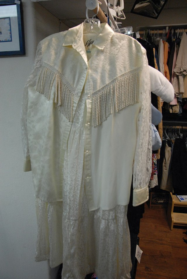 This Western-style wedding dress is a unique clothing item that can be found at M&amp;M&#39;s Secondhand Store on Fourth Street. M&amp;M&#39;s owner Michelle Nolan likes running the store because she comes across items like this every day.