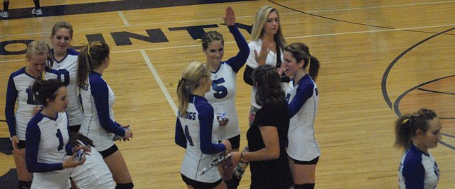 The Moffat County High School volleyball team celebrates after a win at MCHS earlier this season. The Bulldogs' season came to an end Monday when they were not selected for a 3A regional pairing. They finished 5-18.