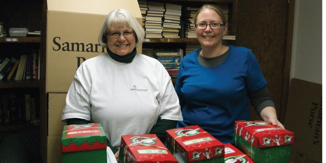 Julie Grobe, left, and Katie Grobe, stand with shoe boxes donated to Operation Christmas Child at Calvary Baptist Church, 1050 Yampa Ave. in Craig. Julie said she hopes to collect 600 boxes by Sunday. 143 already have been donated.