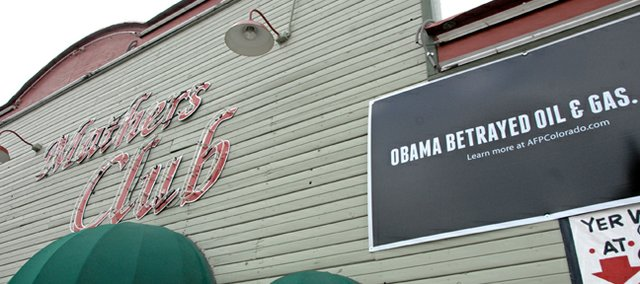 "An ""Obama betrayed oil & gas"" sign hangs above the front entrance to Mathers' Bar, 420 Yampa Ave. Owner, and Moffat County Commissioner, Tom Mathers said this week he is worried about the state of the county following the re-election of President Barack Obama."