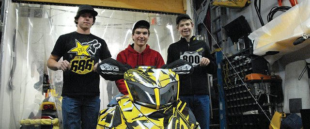 From left: Wesley Chapman, 18, Austin Gabbert, 18, and A.J. Stoffle, 14, stand with Gabbert&#39;s Snocross sled. The Craig residents and Snocross competitors started driving today for the International Series of Champions season kickoff in Duluth, Minn. They will race Nov. 23-25, and race throughout the winter around Colorado and Wyoming.
