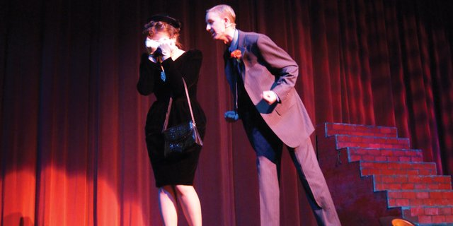 "Miss Adelaide, left, played by Nicole Prestangen, cries during the song ""Sue Me,"" as Nathan Detroit, played by Mitch Romney, tells her to sue him and he loves her during the MCHS performance of ""Guys and Dolls"" on Friday evening."