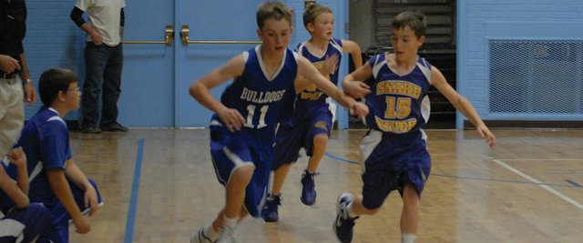 Cole White (11) chases down a loose ball against Little Snake River School last Thursday. White the seventh grade basketball teams from Craig Middle School split their two games against Rangely Saturday morning.