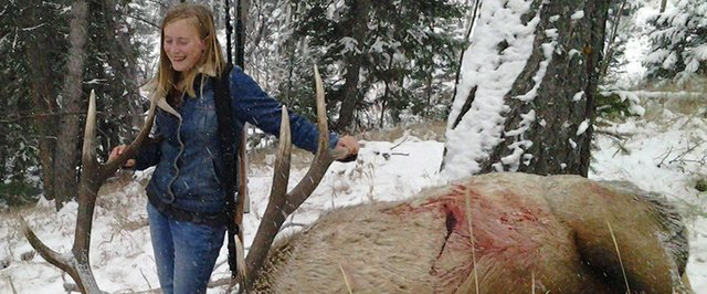 Kendra Halder, 13, of Yampa, stands over the bull she killed during the second elk season in GMU 15 this year. The 6x6 was her first bull, and bigger than anything either of her parents has ever killed.