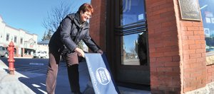 "Mainstreet Steamboat Springs Manager Tracy Barnett puts doormats out in front of downtown businesses that are participating in ""Sweet Treats on MainStreet"" on Saturday as a part of a larger event, Small Business Saturday, which was started by American Express to promote shopping locally."