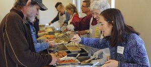 Karina Craig dishes out some Thanksgiving dinner Thursday at the annual Community Thanksgiving Dinner in Steamboat Springs.