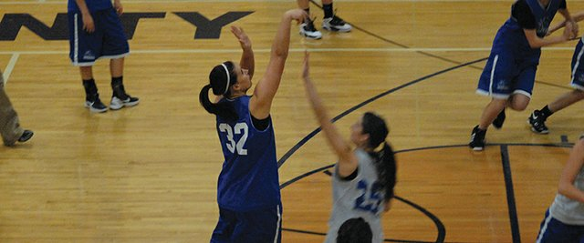 Senior Kori Finneman attempts a three-pointer during Moffat County's girls basketball practice. Finneman is one of seven seniors who will lead the Bulldogs in the 2012-13 season.